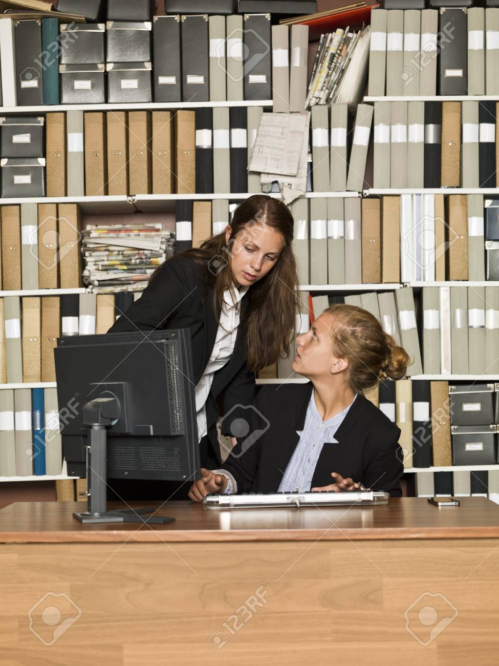 Two businesswomen in front of a computer Stock Photo - 14903425