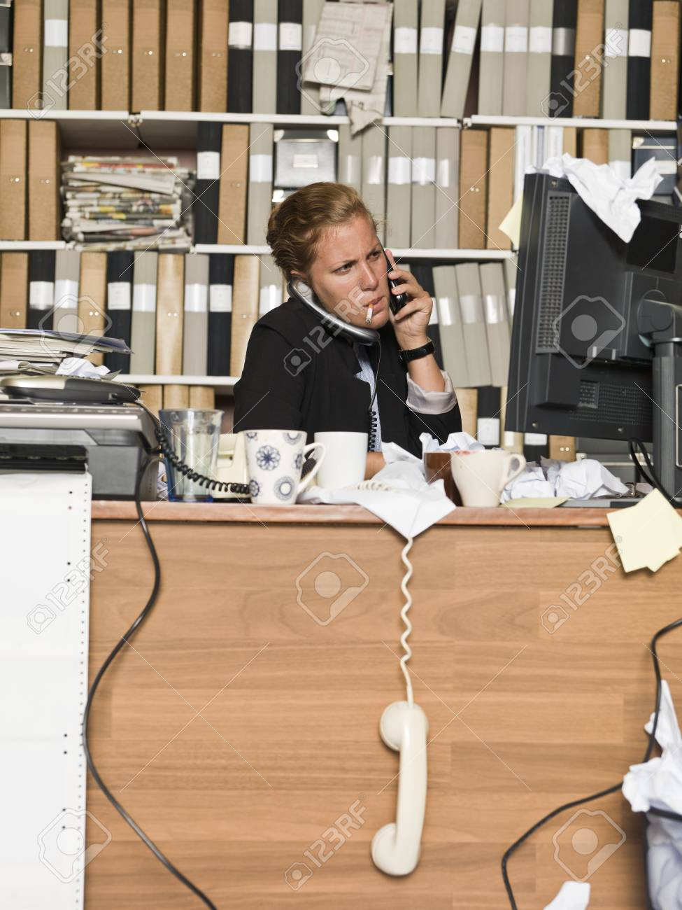 Busy Businesswomen smoking at the office Stock Photo - 14903433