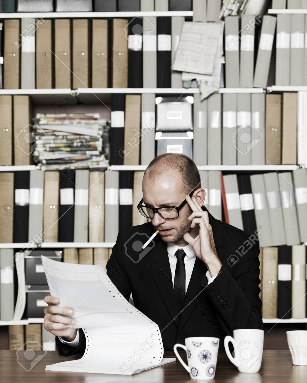 Businessman with cigarette at the office Stock Photo - 16009225