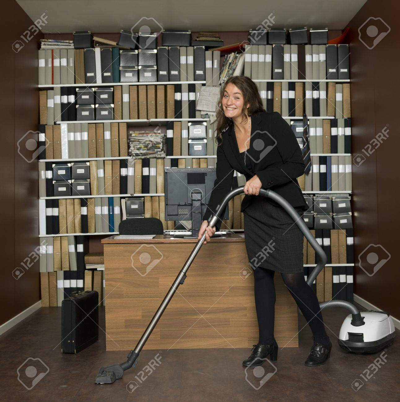 Young woman cleaning the office Stock Photo - 16009229