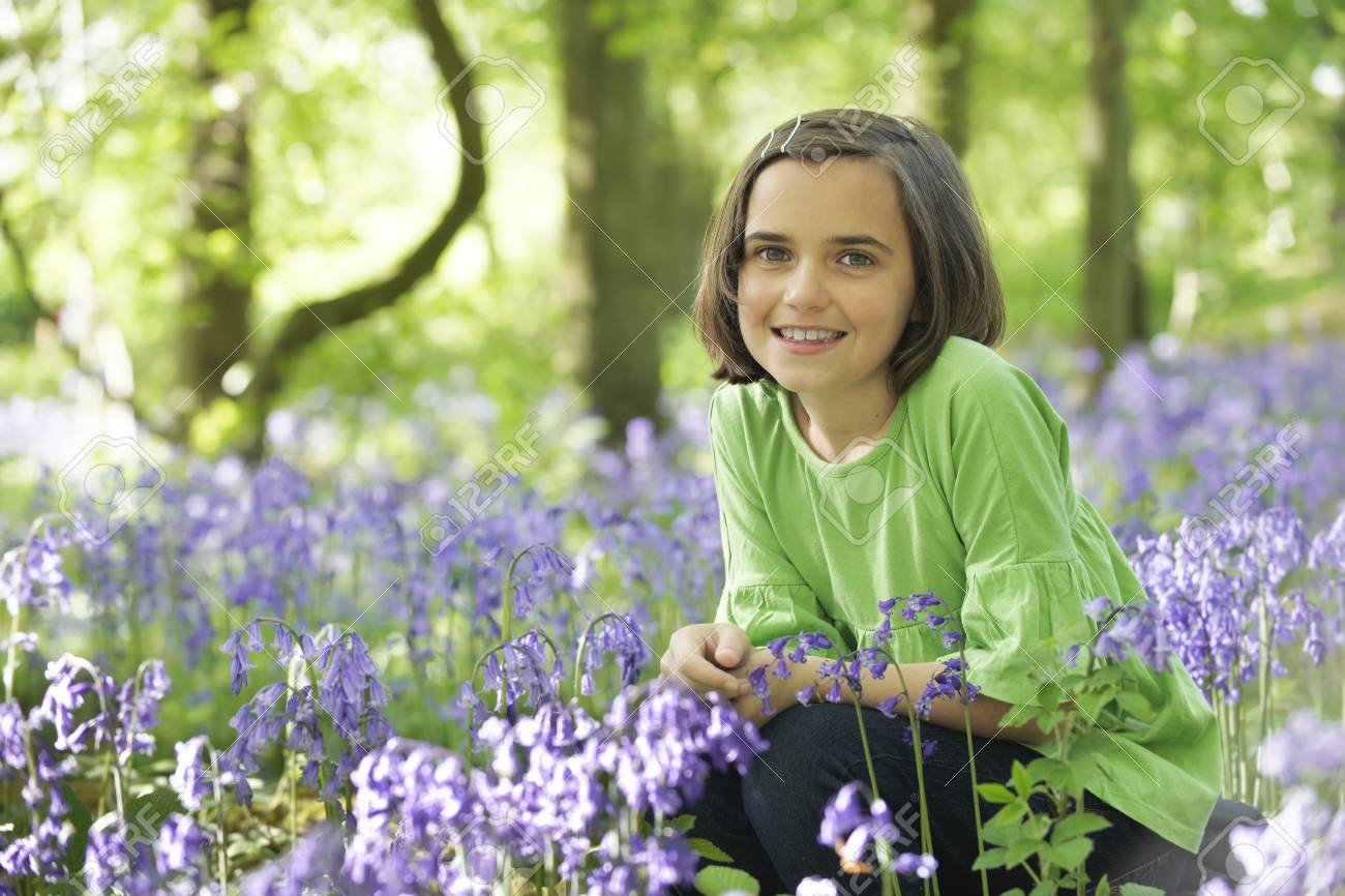 young girl sitting in a wood full of bluebells Stock Photo - 6837728