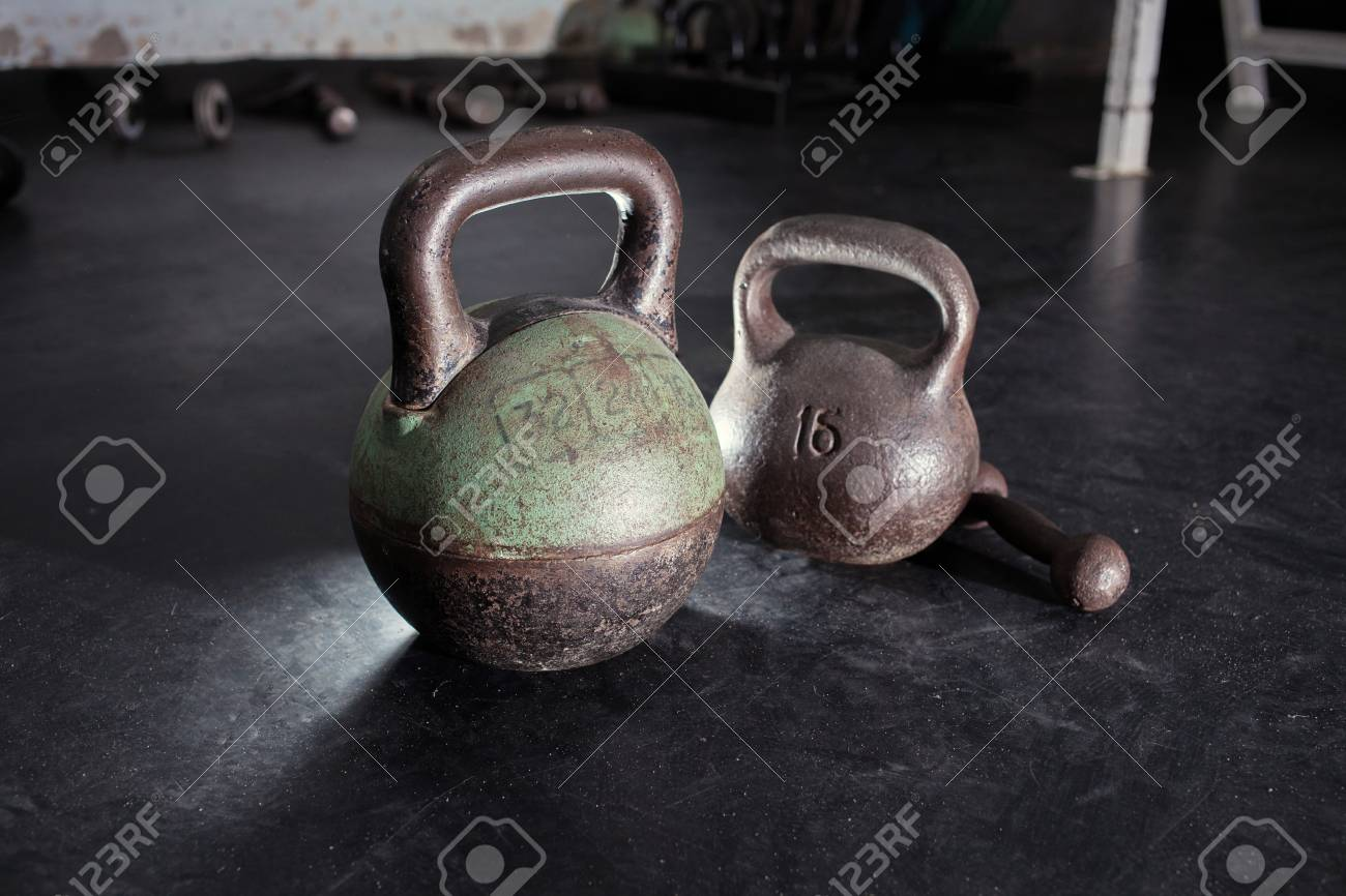 Dumbbells in the old gym room. 16 24 kg stock photo picture and