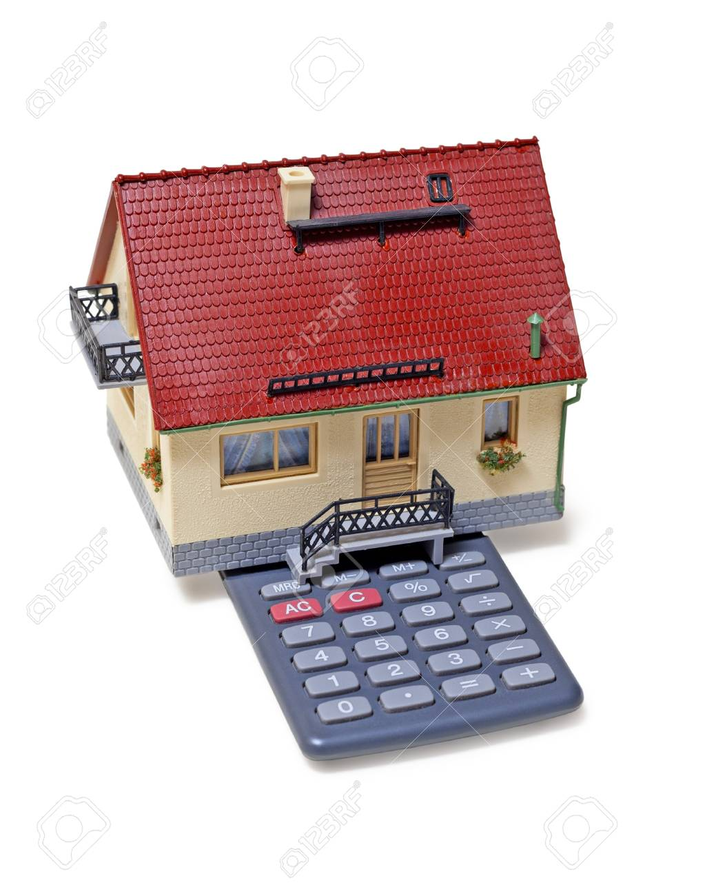 Model house and calculator on white background Stock Photo - 19595840