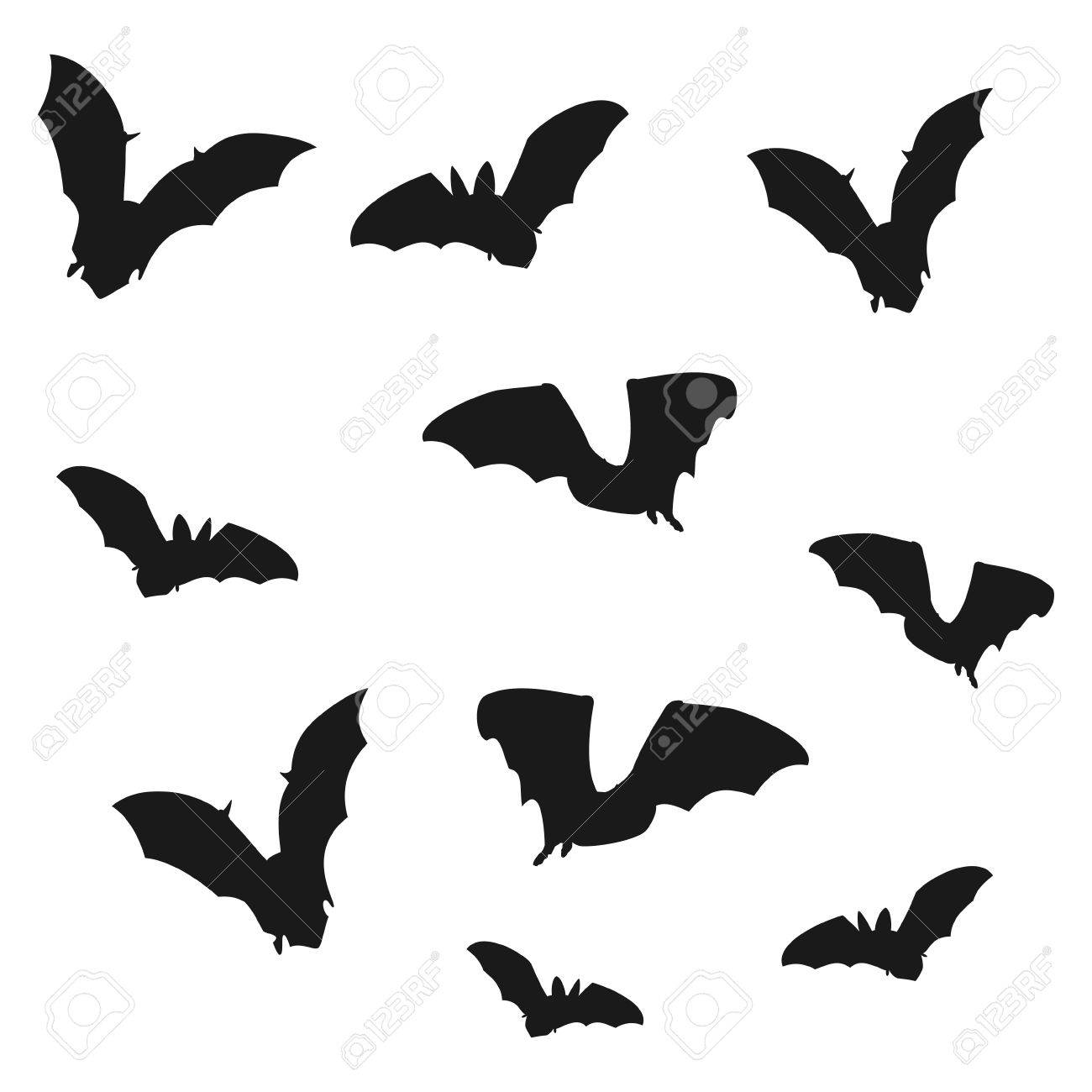 flock of bats black shadows of bats on a white background vector