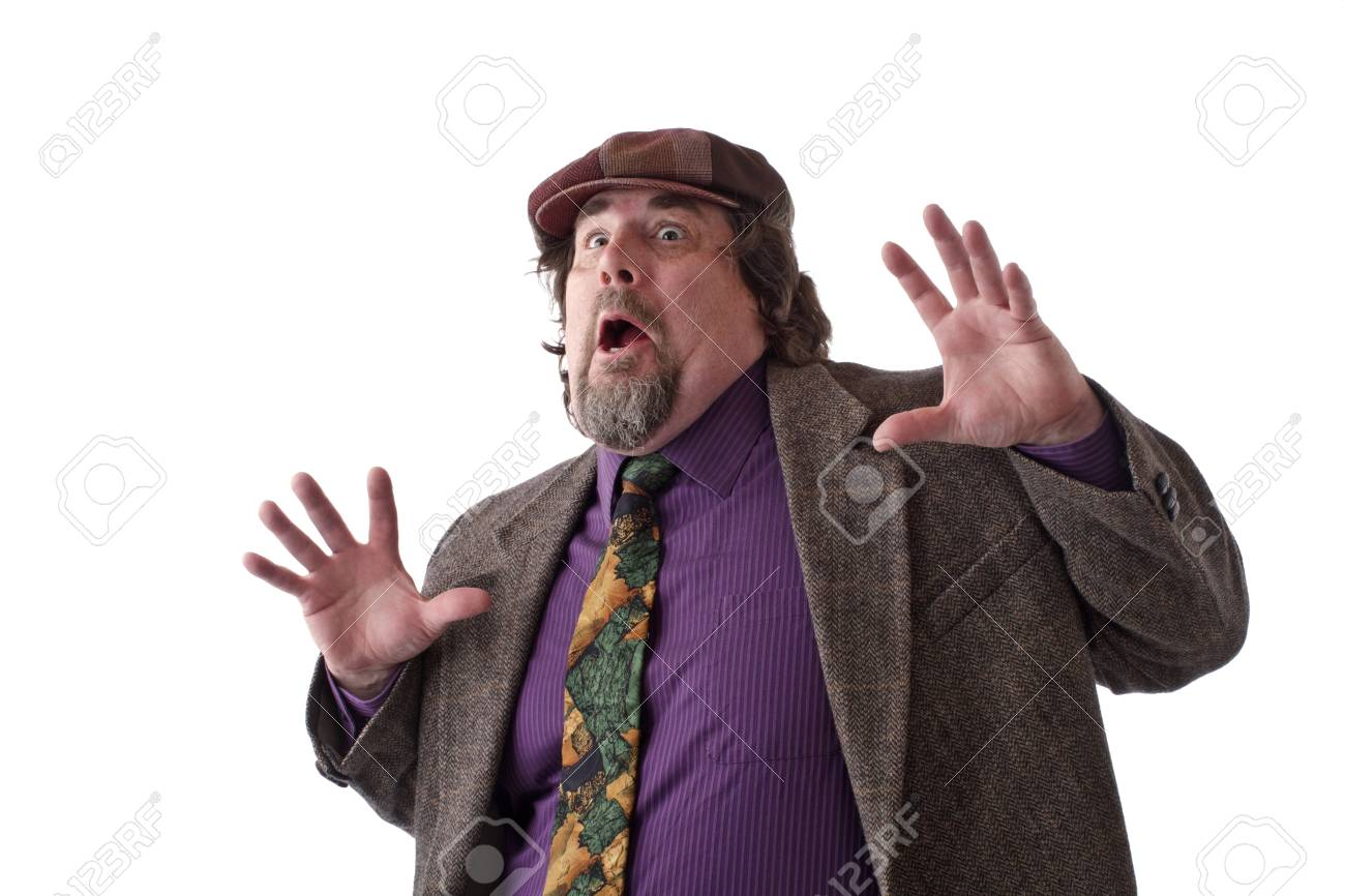 Heavy middle-aged man with goatee, cap and tweed jacket has hands flung up and mouth wide open. Horizontal, isolated on white, copy space. Stock Photo - 14570209