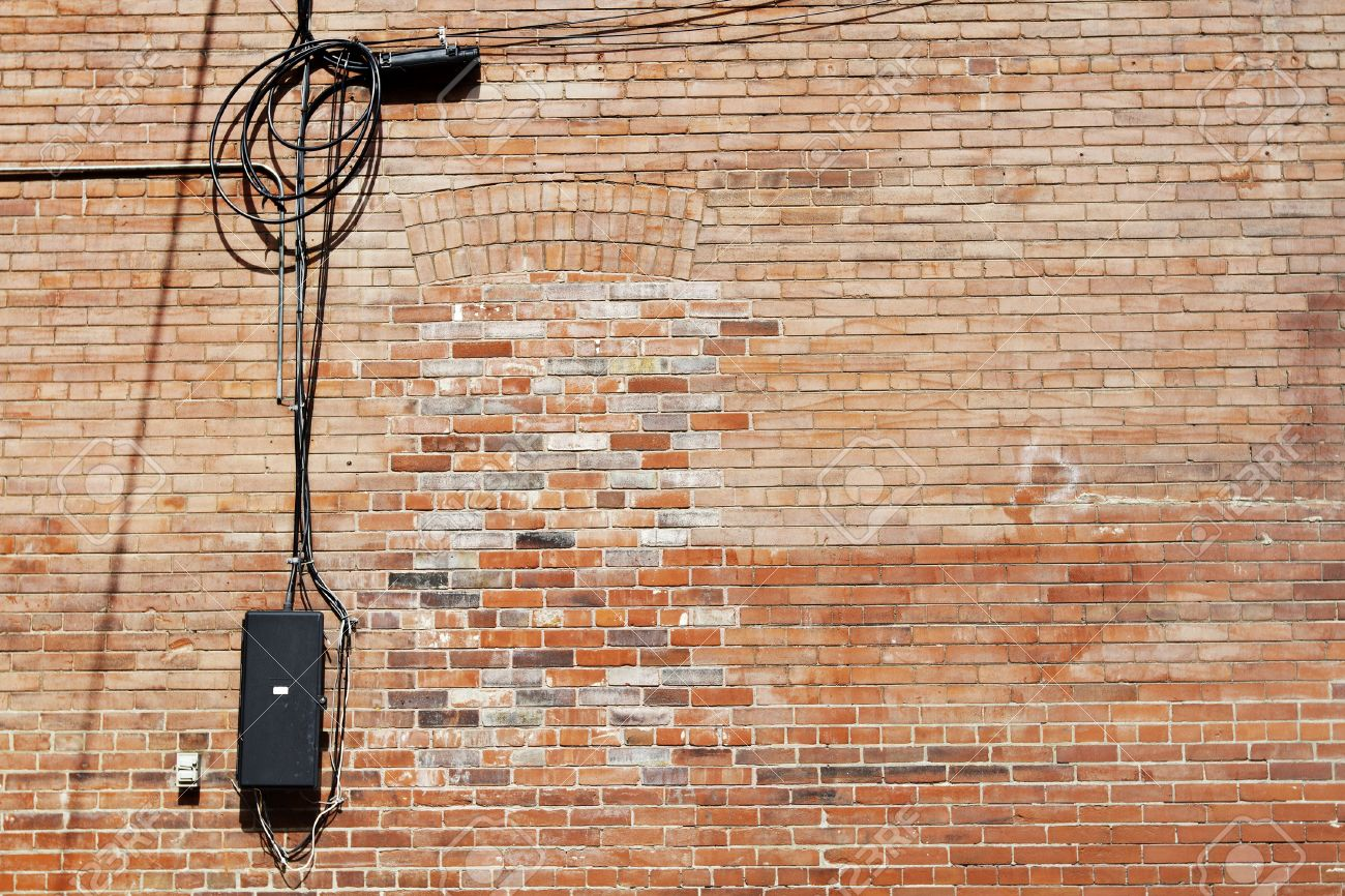 Awe Inspiring Old Faded Red Brick Wall With Bricked In Window And Dangling Stock Wiring Digital Resources Indicompassionincorg