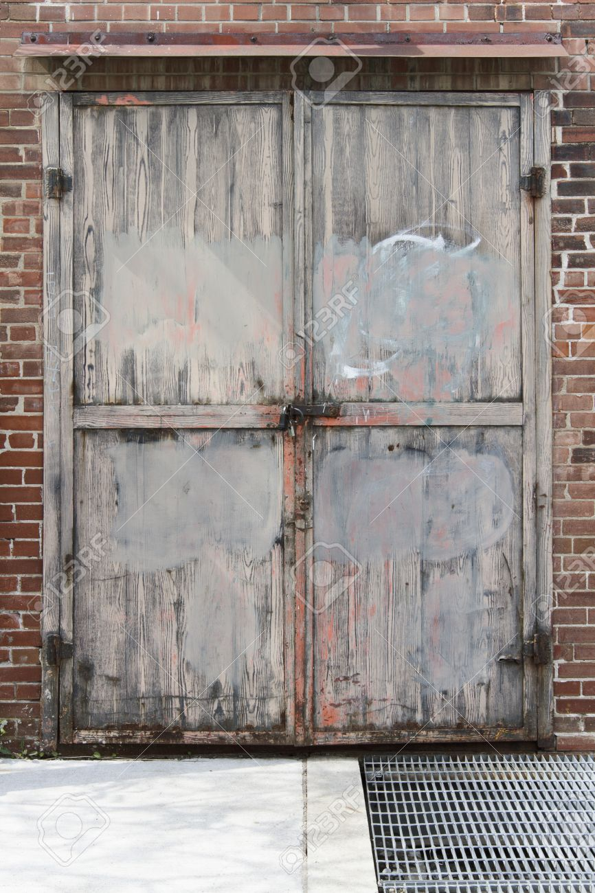Stock Photo - Weathered pink and gray painted wooden exterior double doors from old brick factory & Weathered Pink And Gray Painted Wooden Exterior Double Doors.. Stock ...