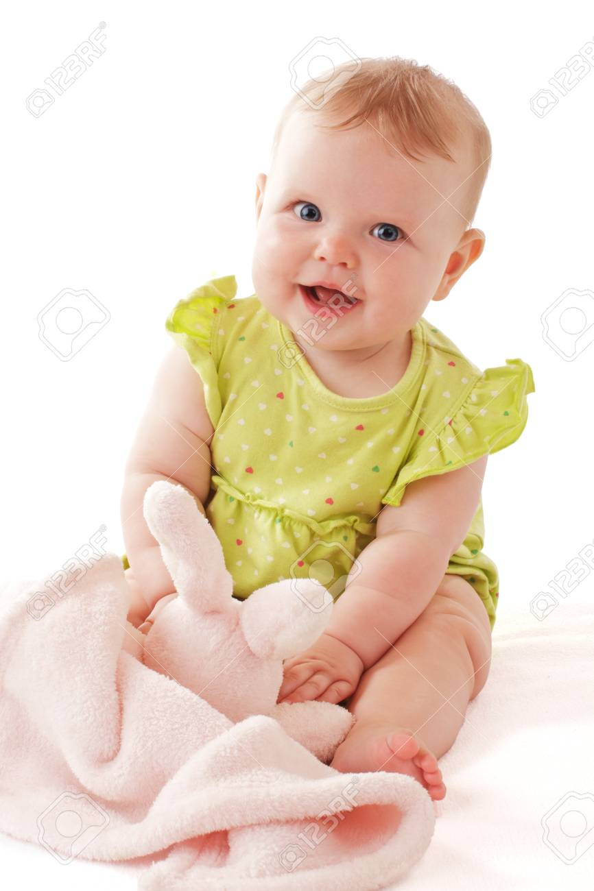 6dfcbecc1d94 Laughing Baby Girl With Big Blue Eyes Sitting And Playing With ...