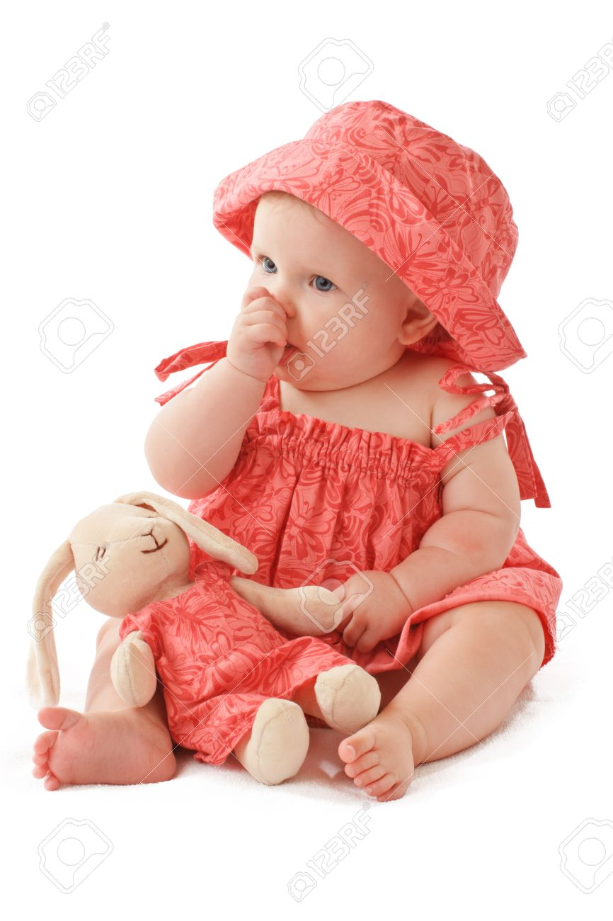 947dc30a93cc Sleepy 6 Month Old Baby Girl Sits Sucking Her Thumb And Holds ...