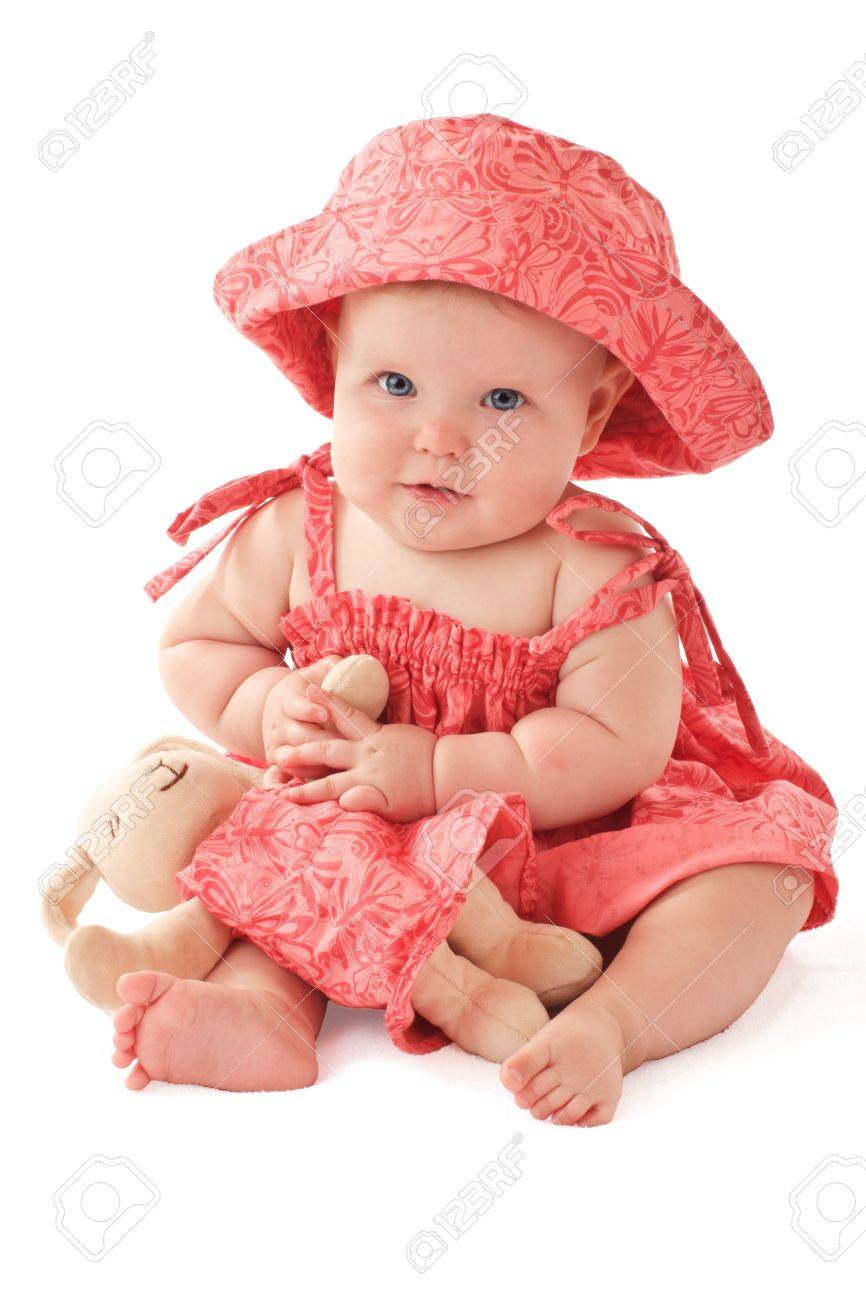 6d56d7c1c712 Smiling 6 Month Old Baby Girl Sits Holding A Stuffed Toy Bunny ...