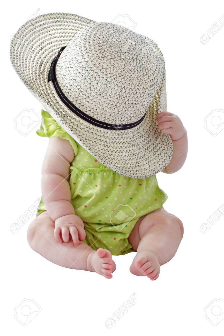 e2f4f6455e4b Happy 6 Month Old Baby Girl In Green Sun Dress Plays Peekaboo ...