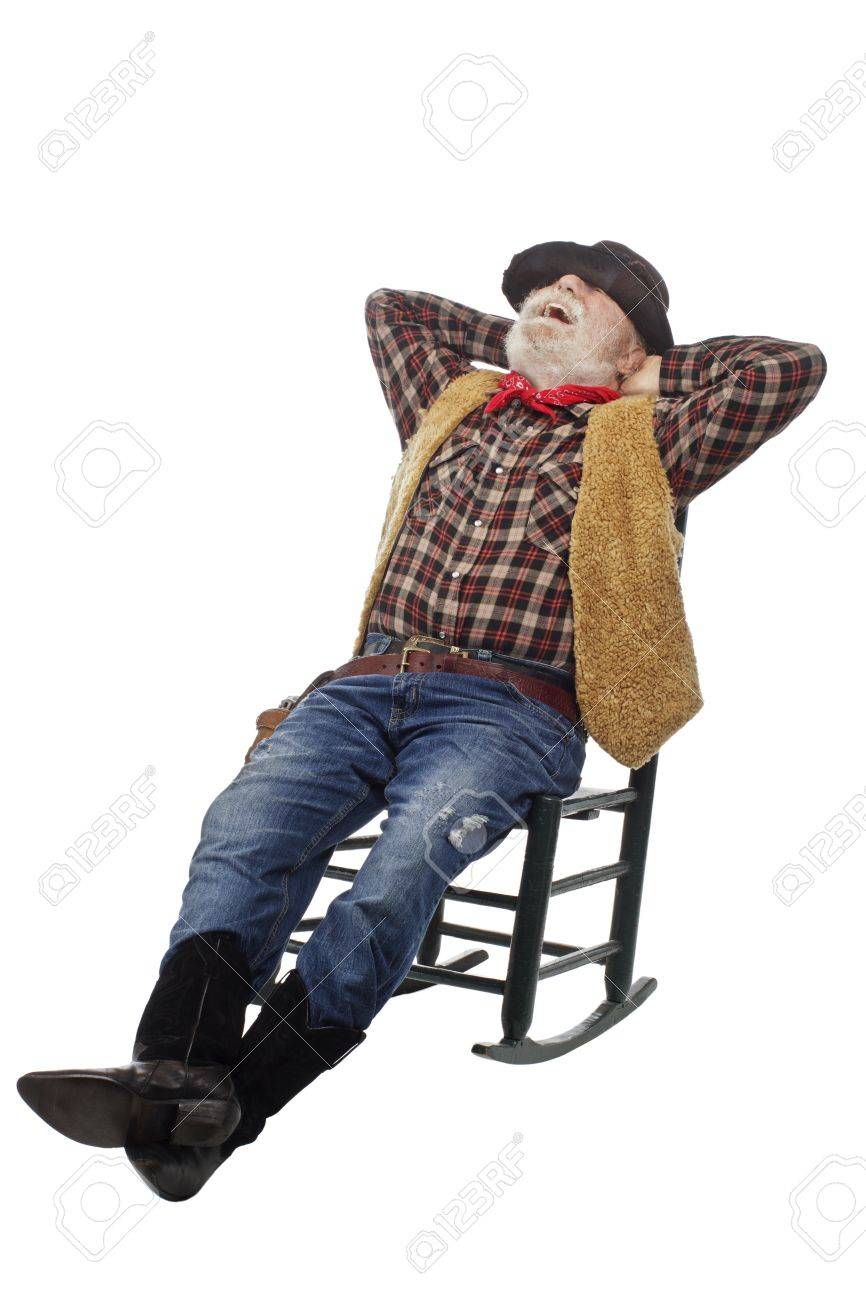 Classic old west style laughing cowboy with felt hat, grey whiskers, revolver. He relaxes leaning back in a rocking chair. Isolated on white, vertical, copy space. Stock Photo - 16980010