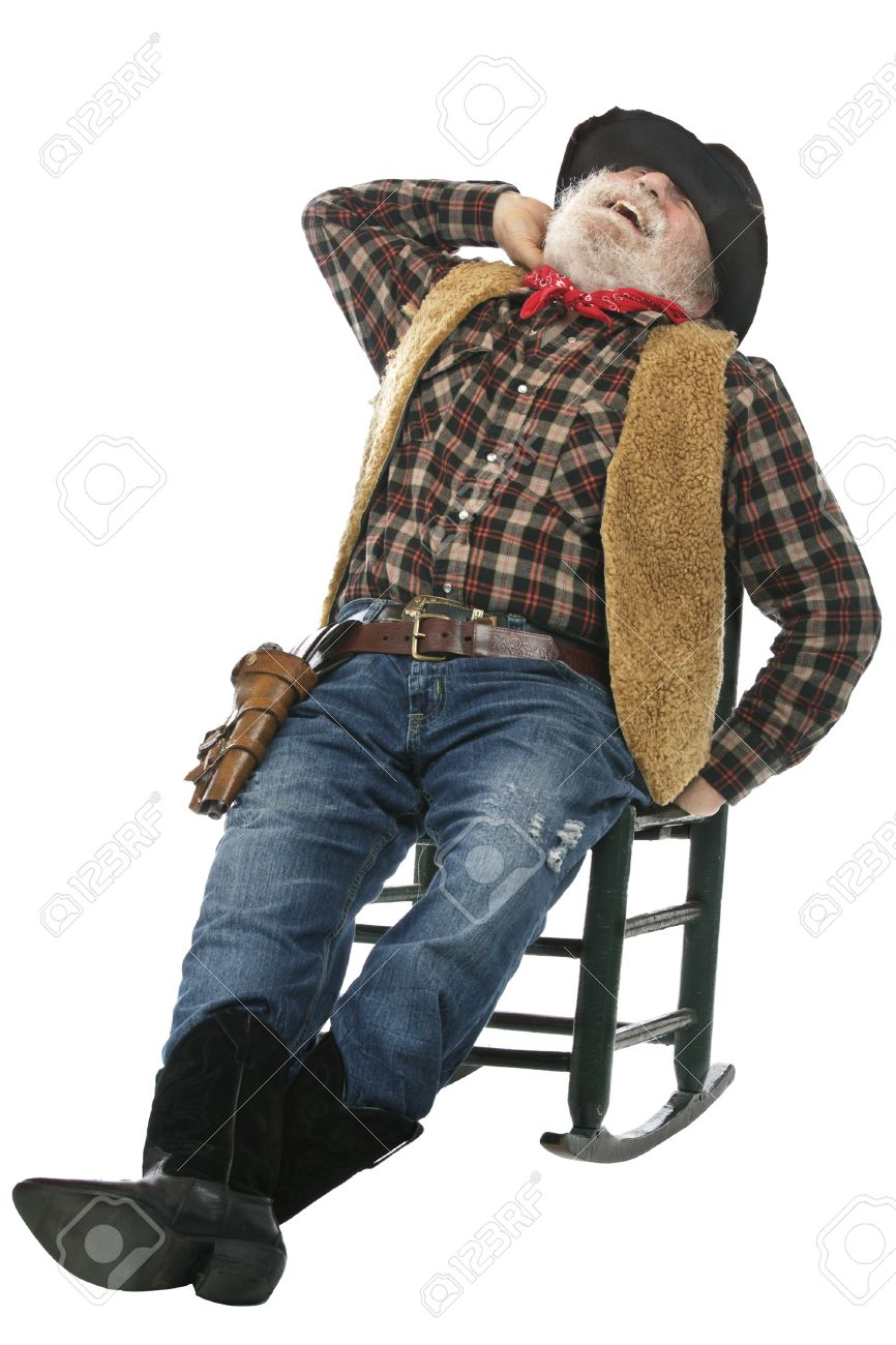 Classic old west style laughing cowboy with felt hat, grey whiskers. He relaxes leaning back in a rocking chair. Isolated on white, vertical, copy space. Stock Photo - 16979994
