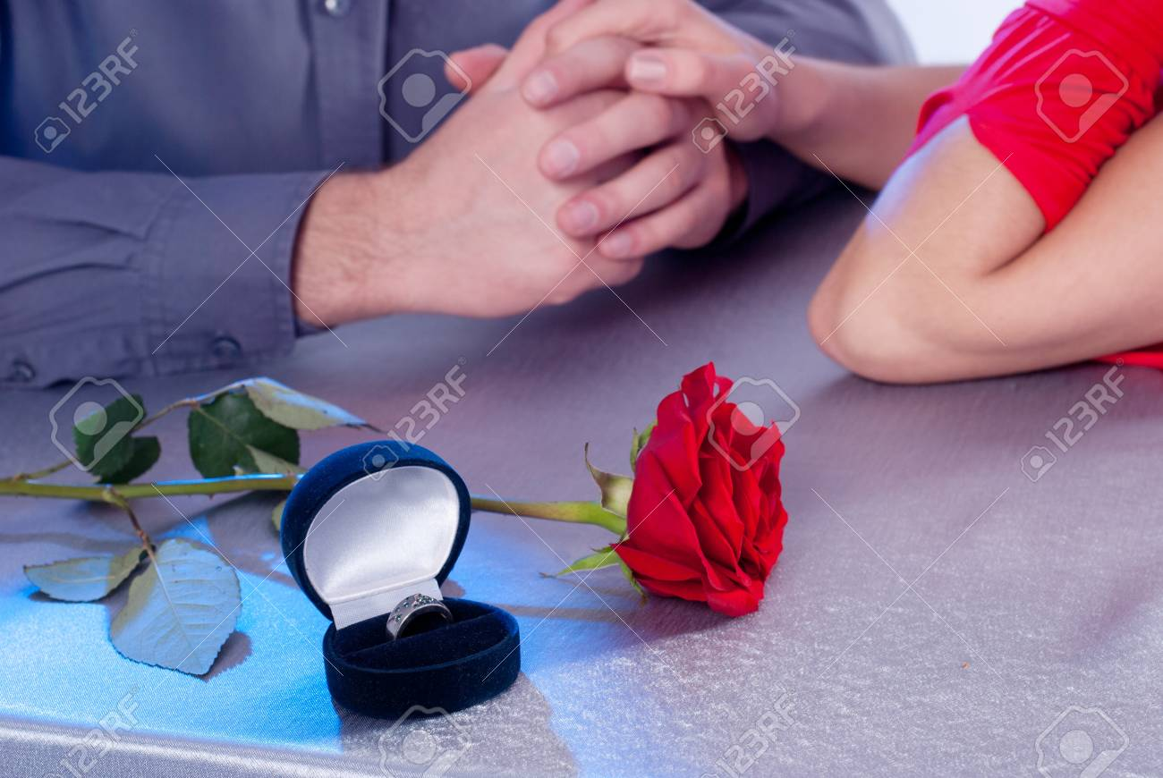 Ring of roses, the couple at the table Stock Photo - 12671266