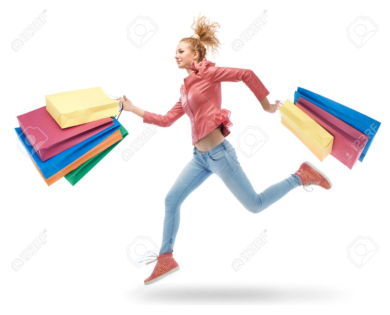 young woman running with shopping bags in hands Stock Photo - 24139081