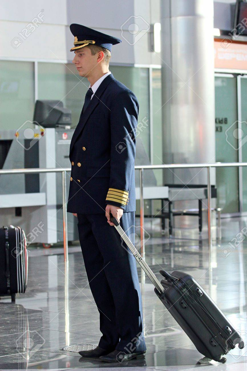 Air  steward in a uniform at the airport Stock Photo - 4903539