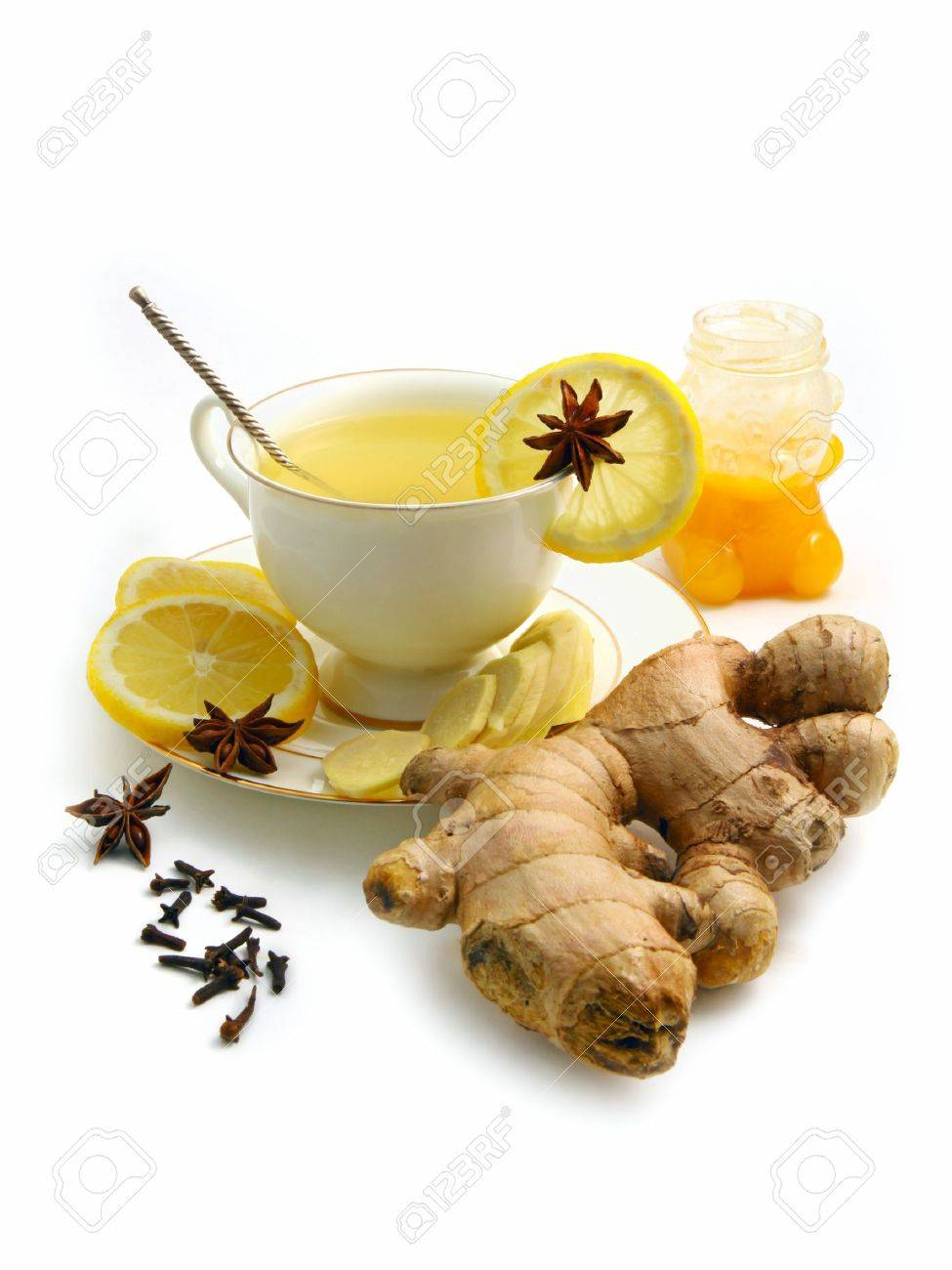 Ginger tea with lemon, honey and  spices isolated on white background Stock Photo - 9737015