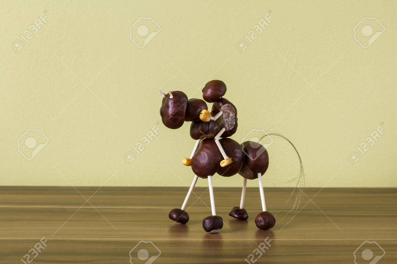 8a4372076d71 doll horse and horseman made of chestnuts on a wooden background Stock  Photo -