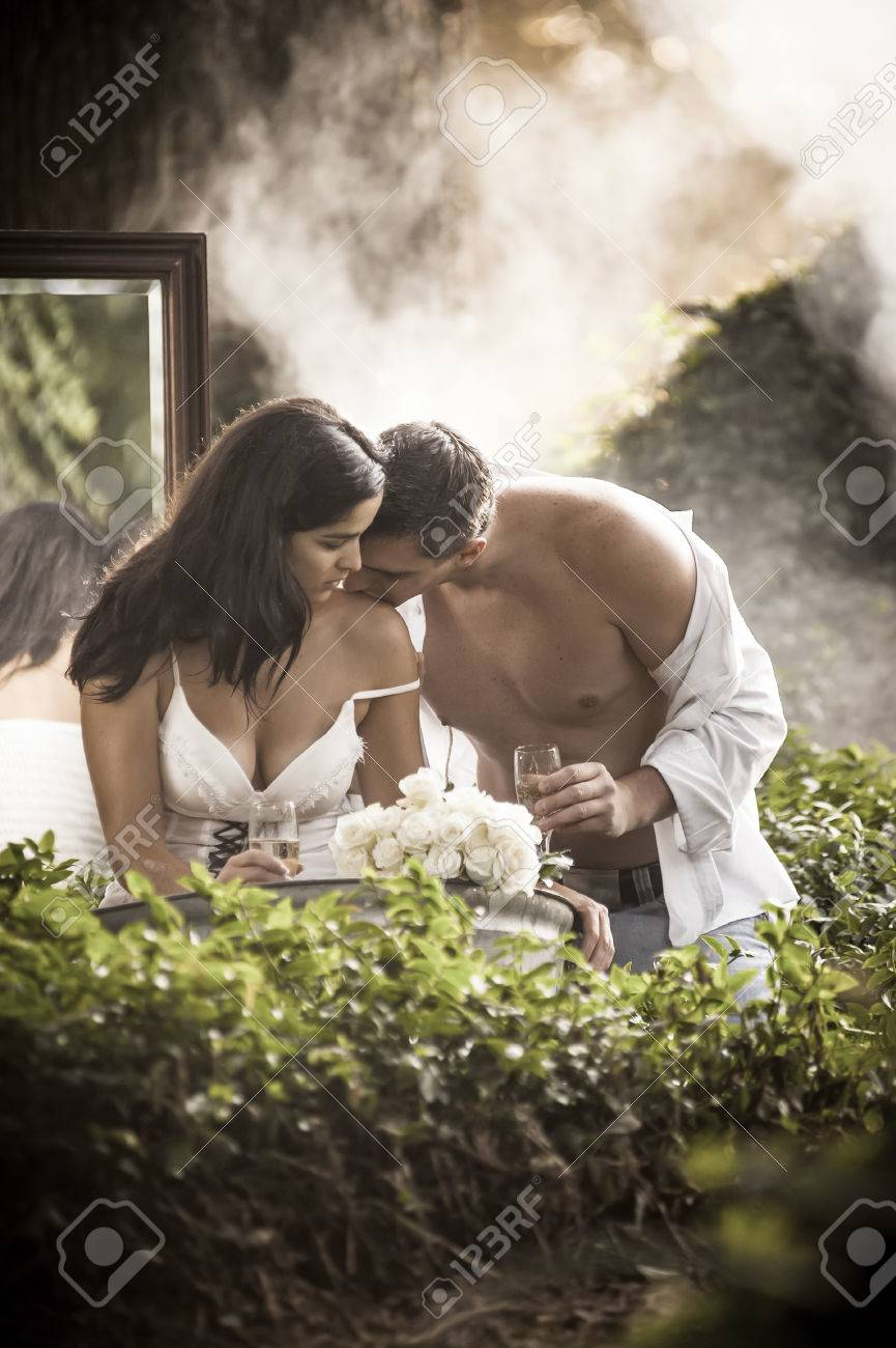 Beautoful in love couple bathing and fliting outdoors in garden through mist - 37163893