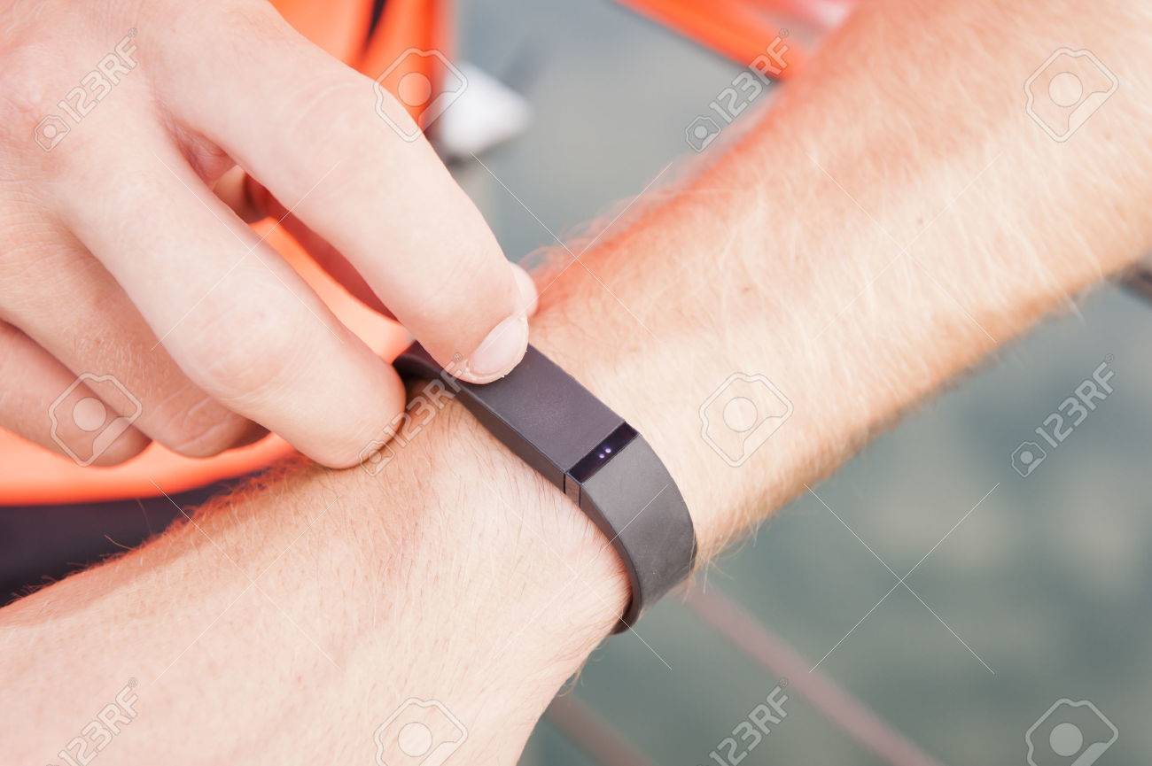 Close up of guy using wearable fitness gear - 37244965
