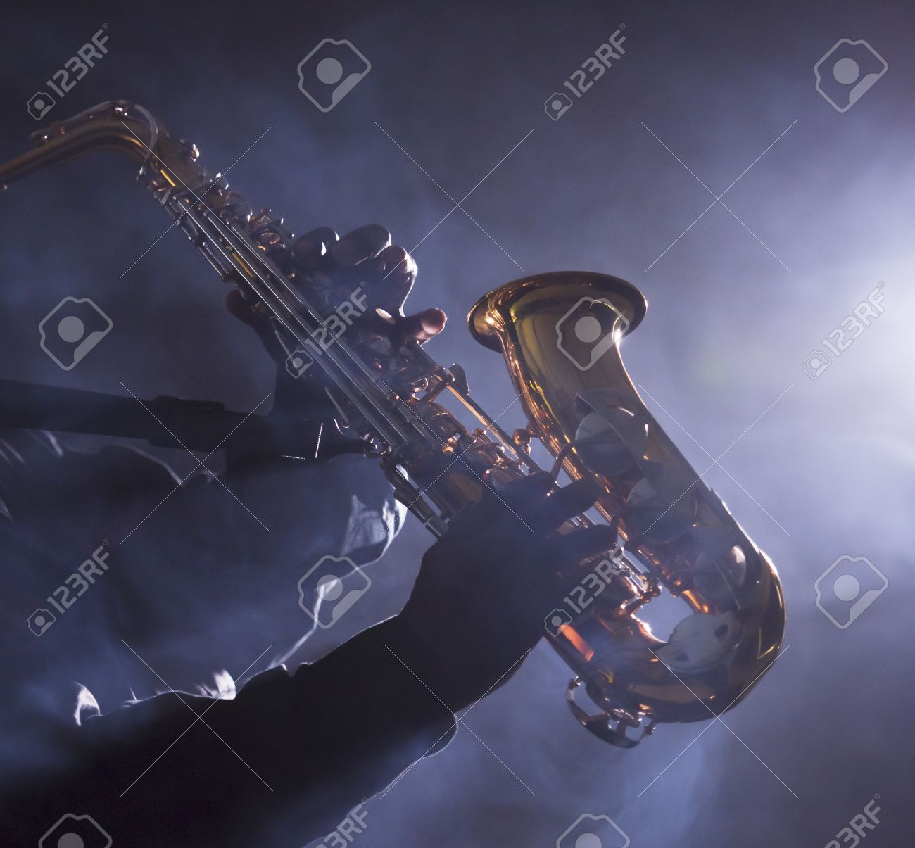 African jazz musician playing the saxophone - 38728296