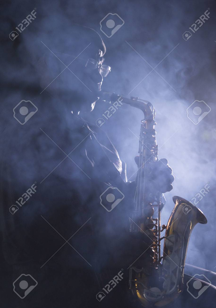 African jazz musician playing the saxophone - 38728314