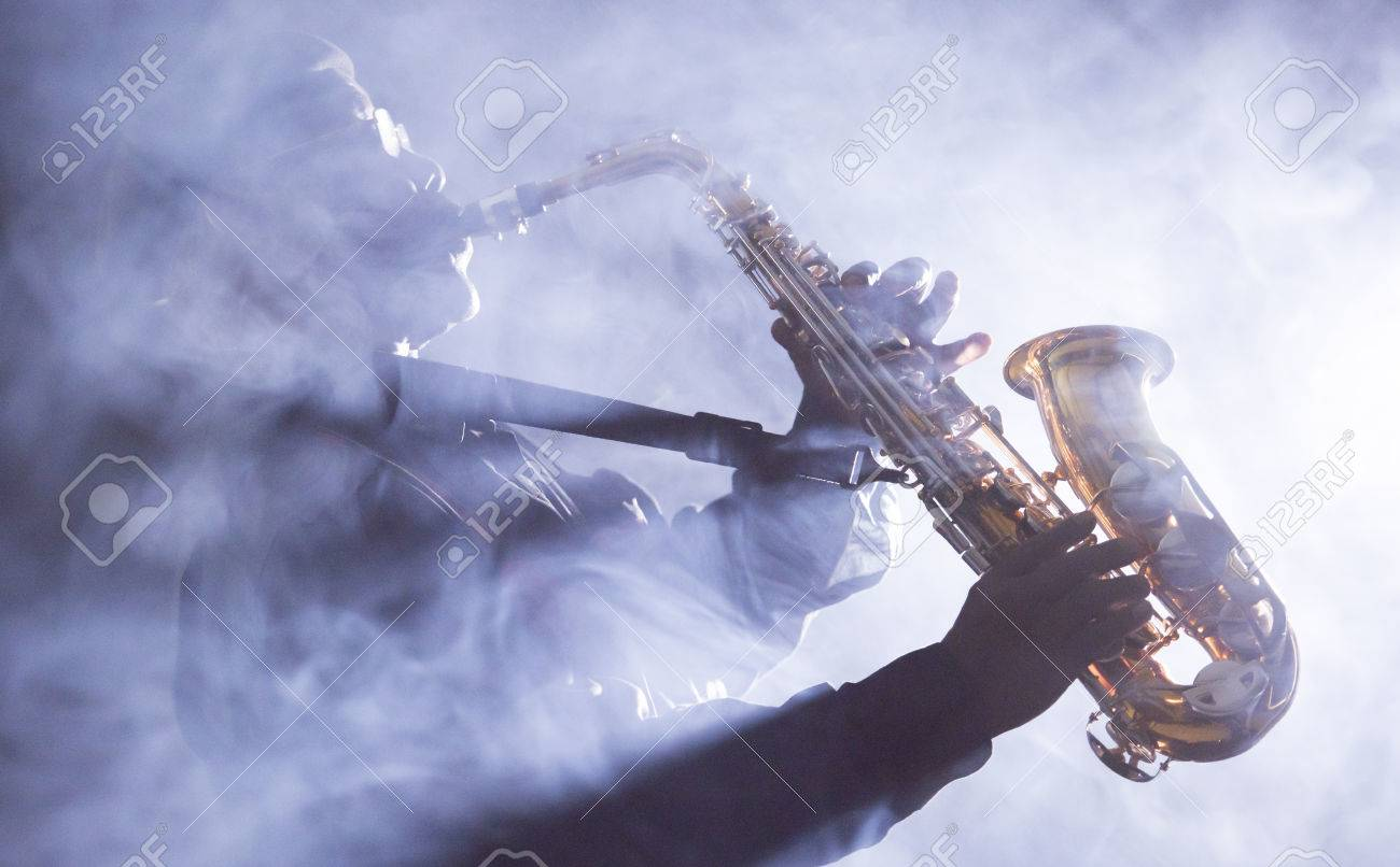 African jazz musician playing the saxophone - 38728342