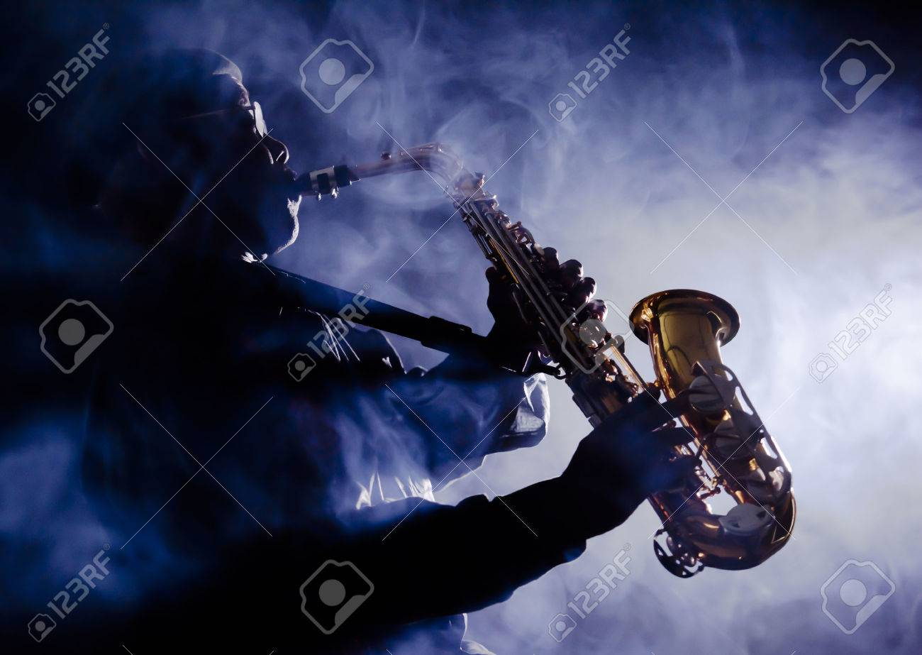 African jazz musician playing the saxophone - 38728354