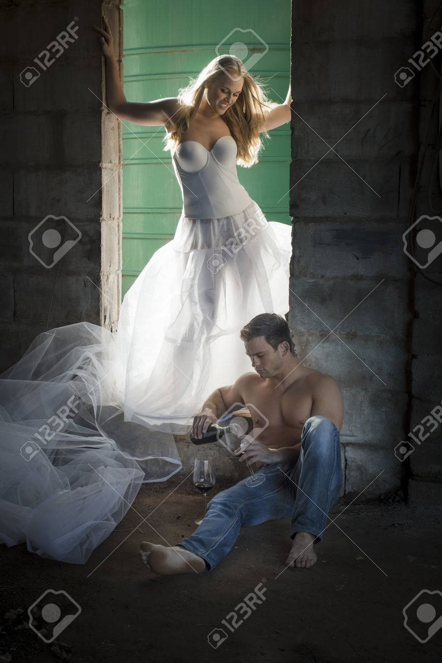 Couple drinking wine in a run down building. - 79148415