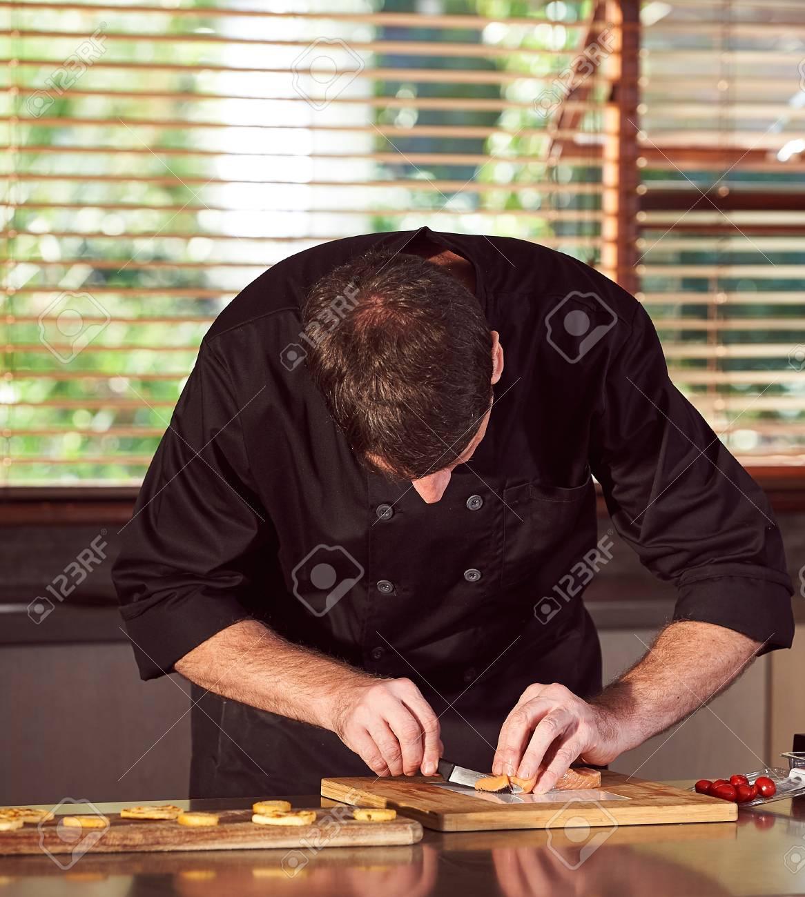 Chef preparing food in kitchen - 72155990