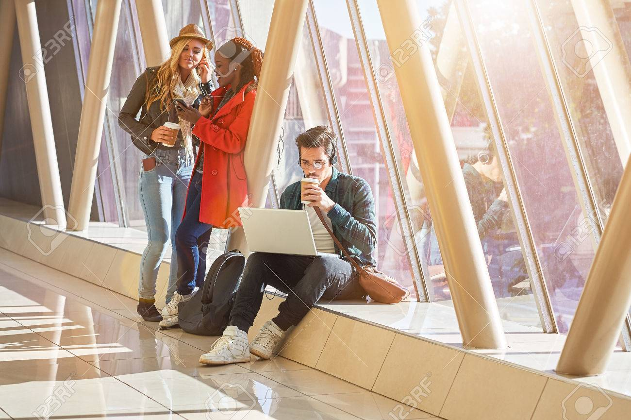 3 young adults entrepreneurs or students group mixed race around laptop having a discussion - 79148436
