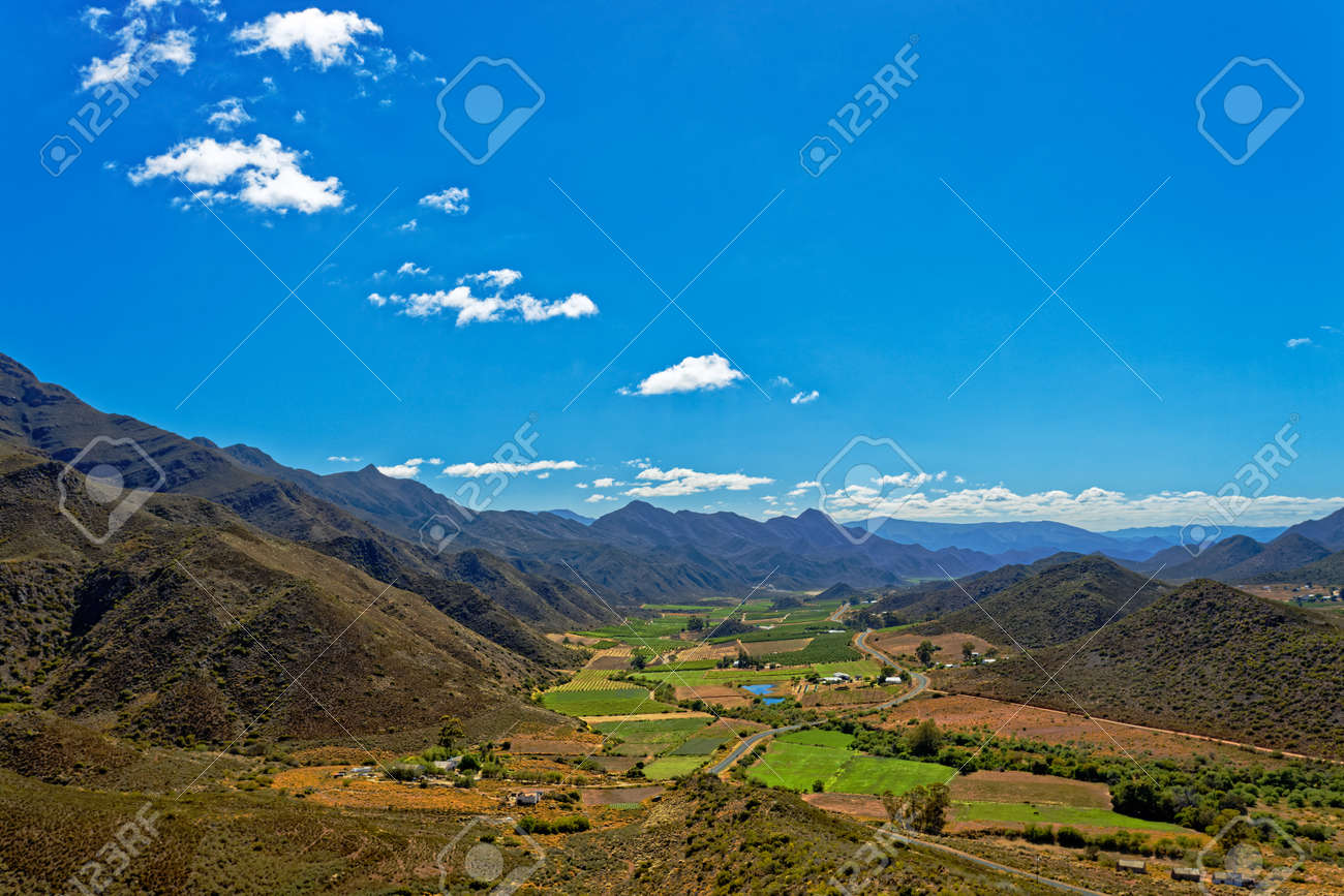 Fertile Koo Valley in Western Cape, South Africa, with farm lands and road - 173811867