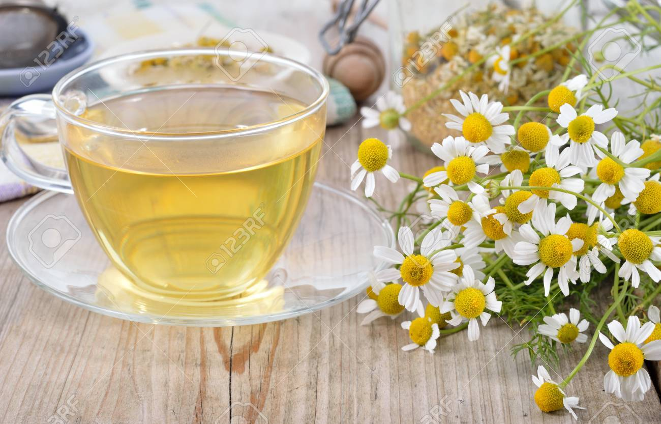 Cup Of Herbal Chamomile Tea On A Wooden Table. Chamomile Tea In A  Transparent Cup And Camomile Flowers On Wooden Table. Herbal Tea For Baby  Stock Photo, Picture And Royalty Free Image.