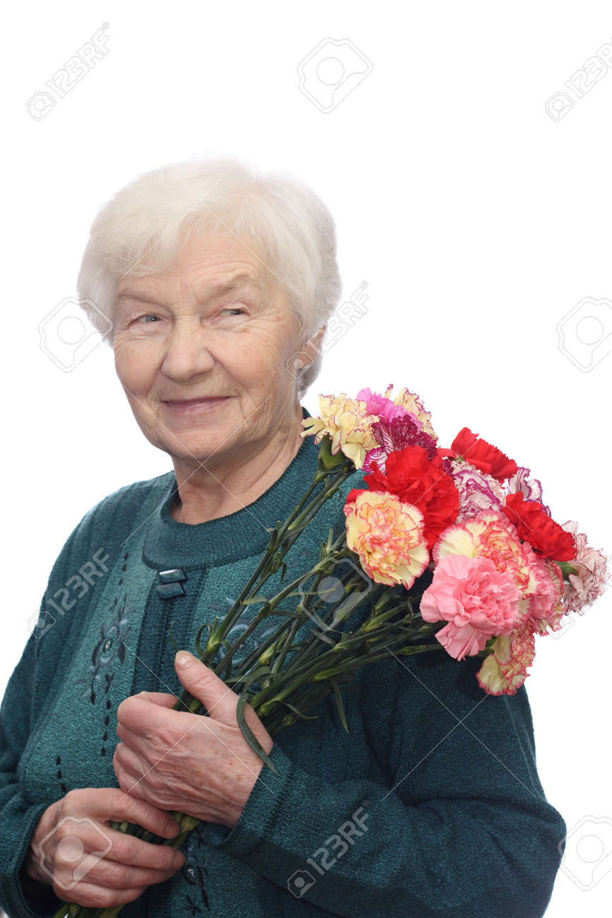 Smiling elderly woman with bunch of flowers, isolated on white background Stock Photo - 1808992