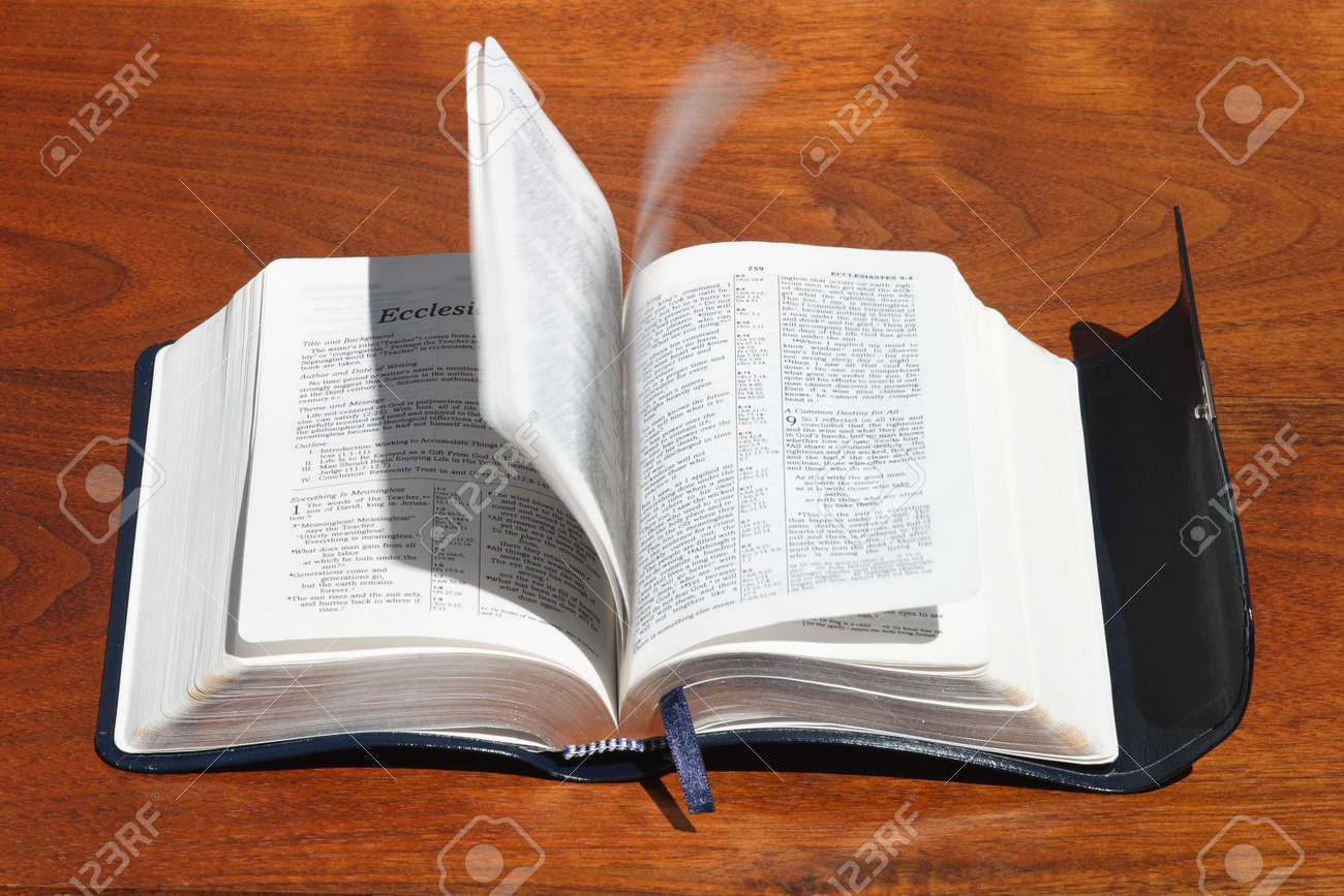 A concept photo of the Holy Spirit turning Bible pages Stock Photo - 946174