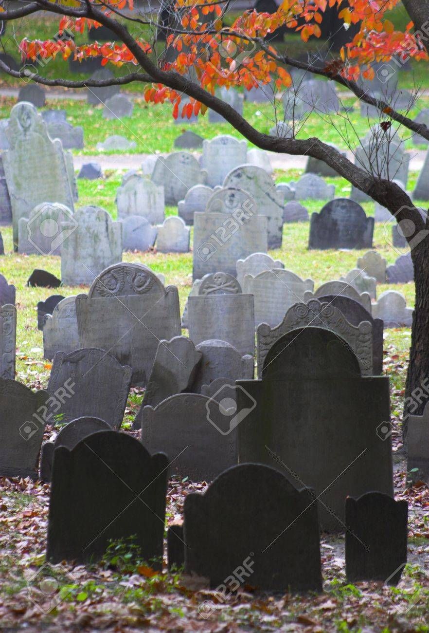 Famous landmark of history cemetery, the Granary Burying ground in Boston in the Autumn, framed with the red maple leaf foliage. Stock Photo - 853329
