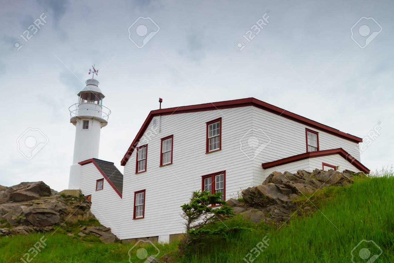 White Lighthouse On The Coast Of Newfoundland, Canada Stock Photo ...