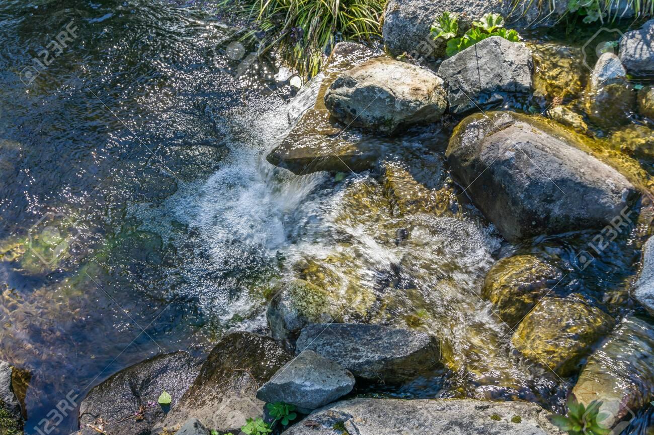 Water rushes over rocks in Seatac, Washington