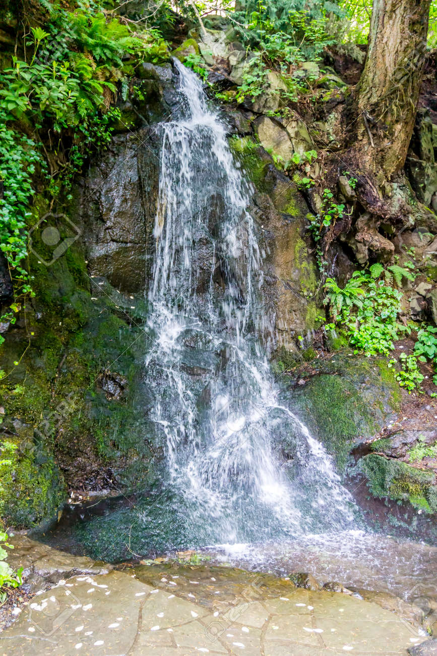 A waterfall flows among large rocks in Tumwater, Washington. - 171118502