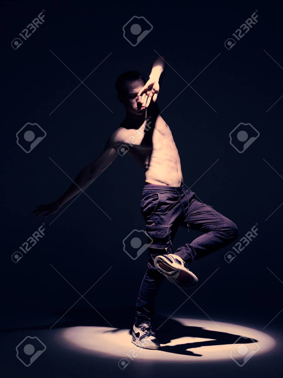 Cool Guy Dancer With Naked Torso Dancing In Studio In Spotlight Stock Photo Picture And Royalty Free Image Image 154083945