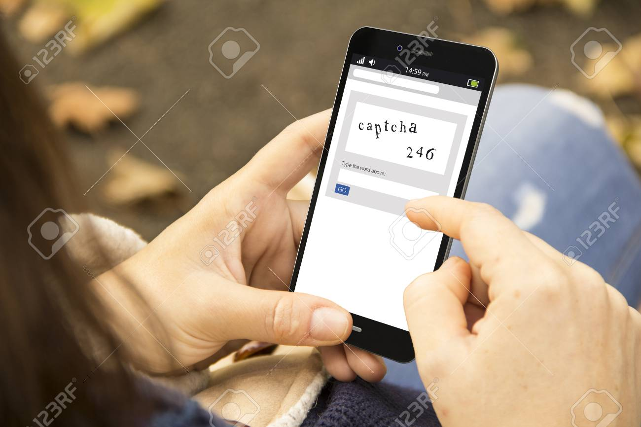 woman holding a 3d generated smartphone with captcha on the screen. Graphics on screen are made up. - 121643972