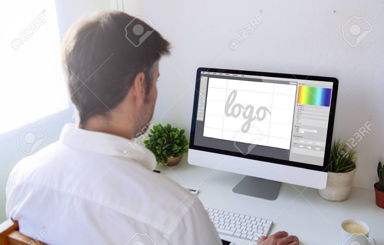 graphic designer designing a on computer. All screen graphics are made up. - 71981192