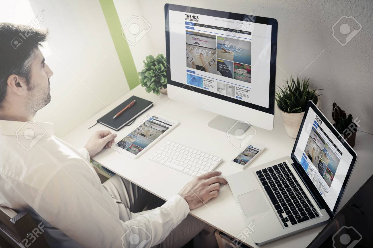 Man Surfing Internet With Devices With Blog Magazine Website