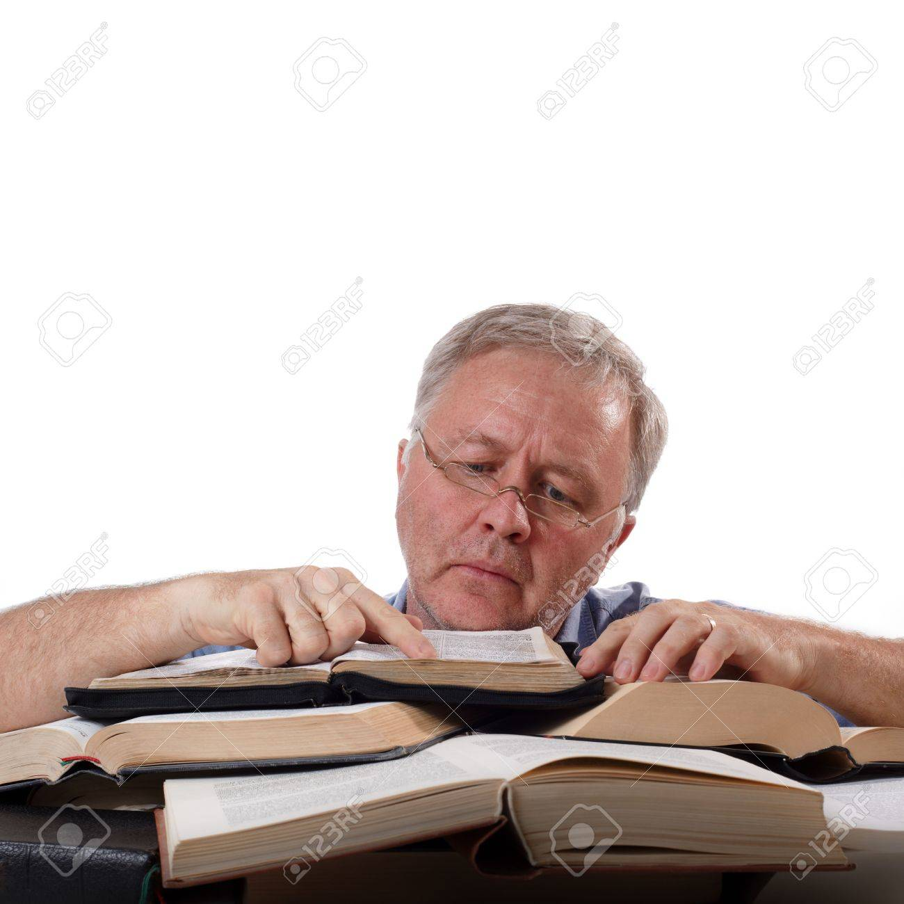 Man with glasses working with many books Stock Photo - 5137080