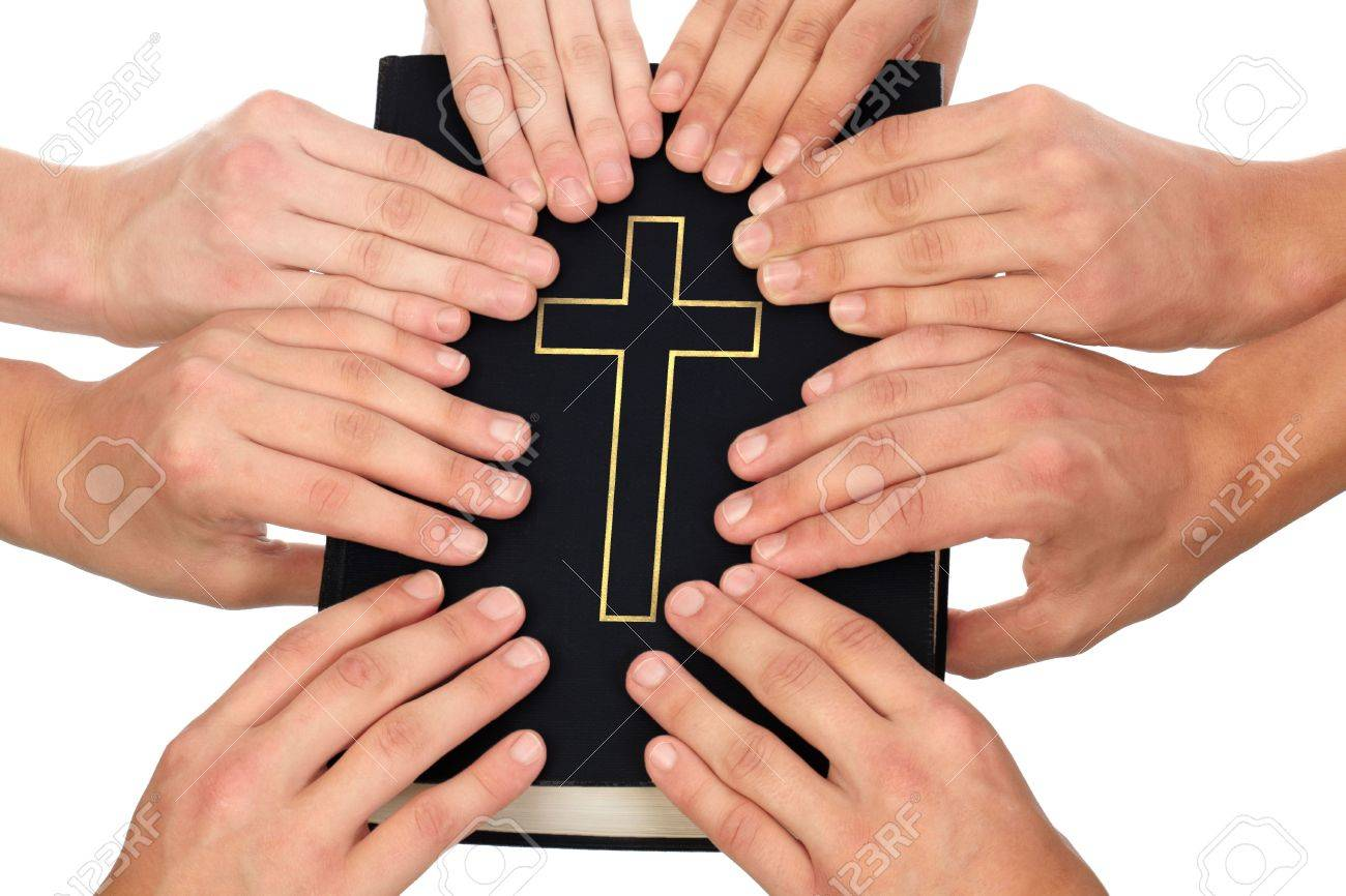 Group of people holding Holy Bible to unity and prayer Stock Photo - 8205388