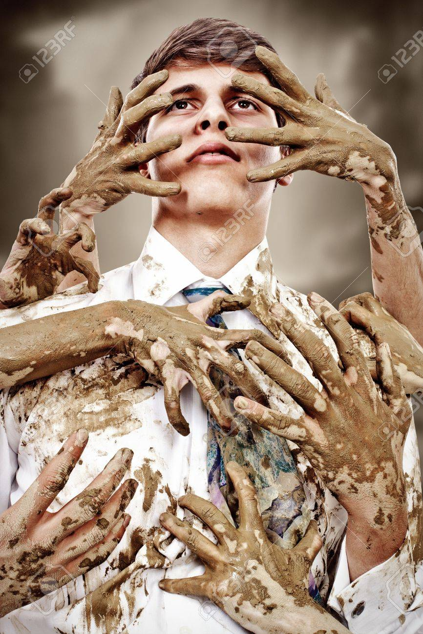 Young man stained by multitude of dirty hands Stock Photo - 18494139