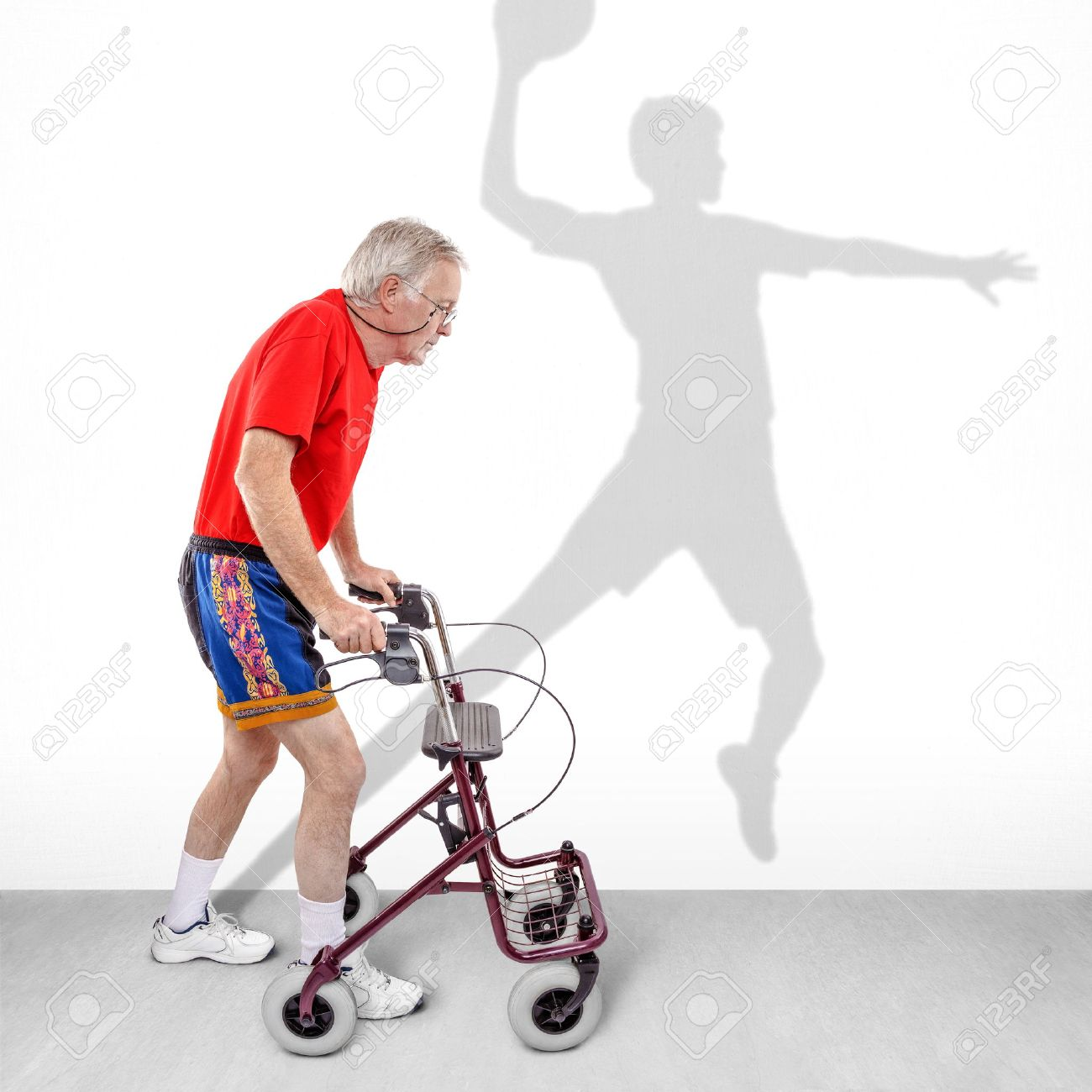 Sick Old Man Walking With A Walker Along With A Shadow Of A Young ...