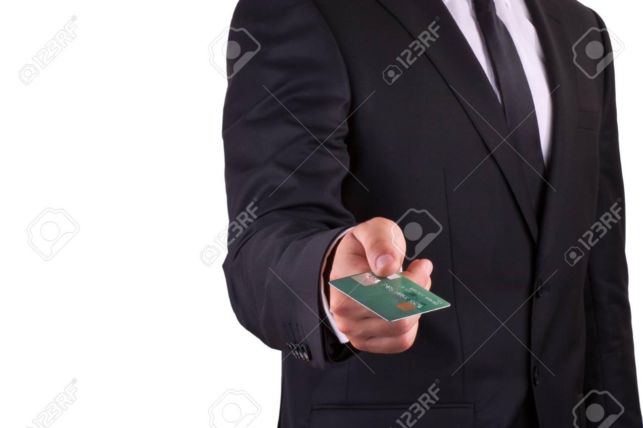 Businessman holding credit card, isolated on white background Stock Photo - 14964131