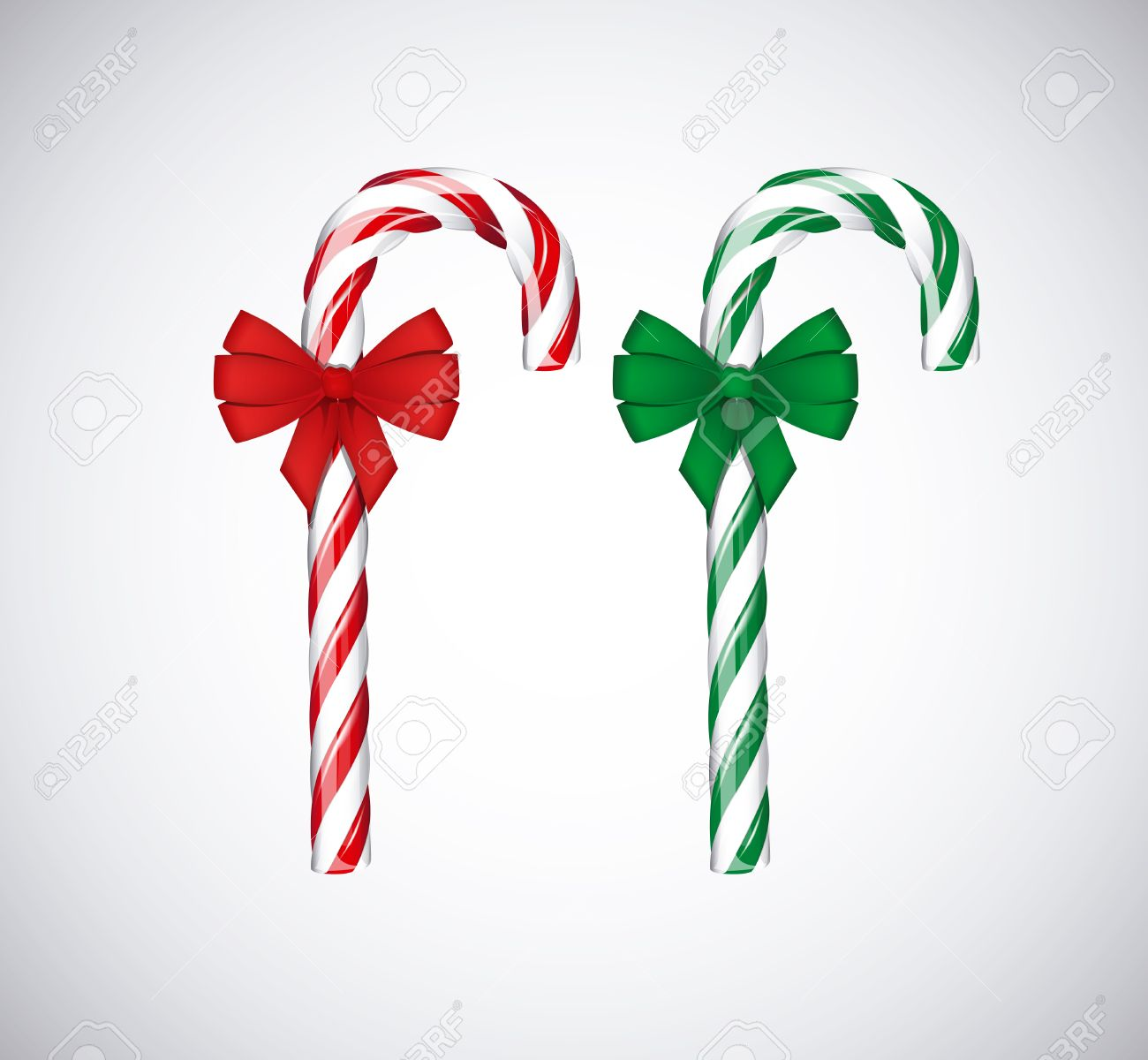 Traditional christmas green and red candy canes with red bow ribbon isolated on white background. - 46577921