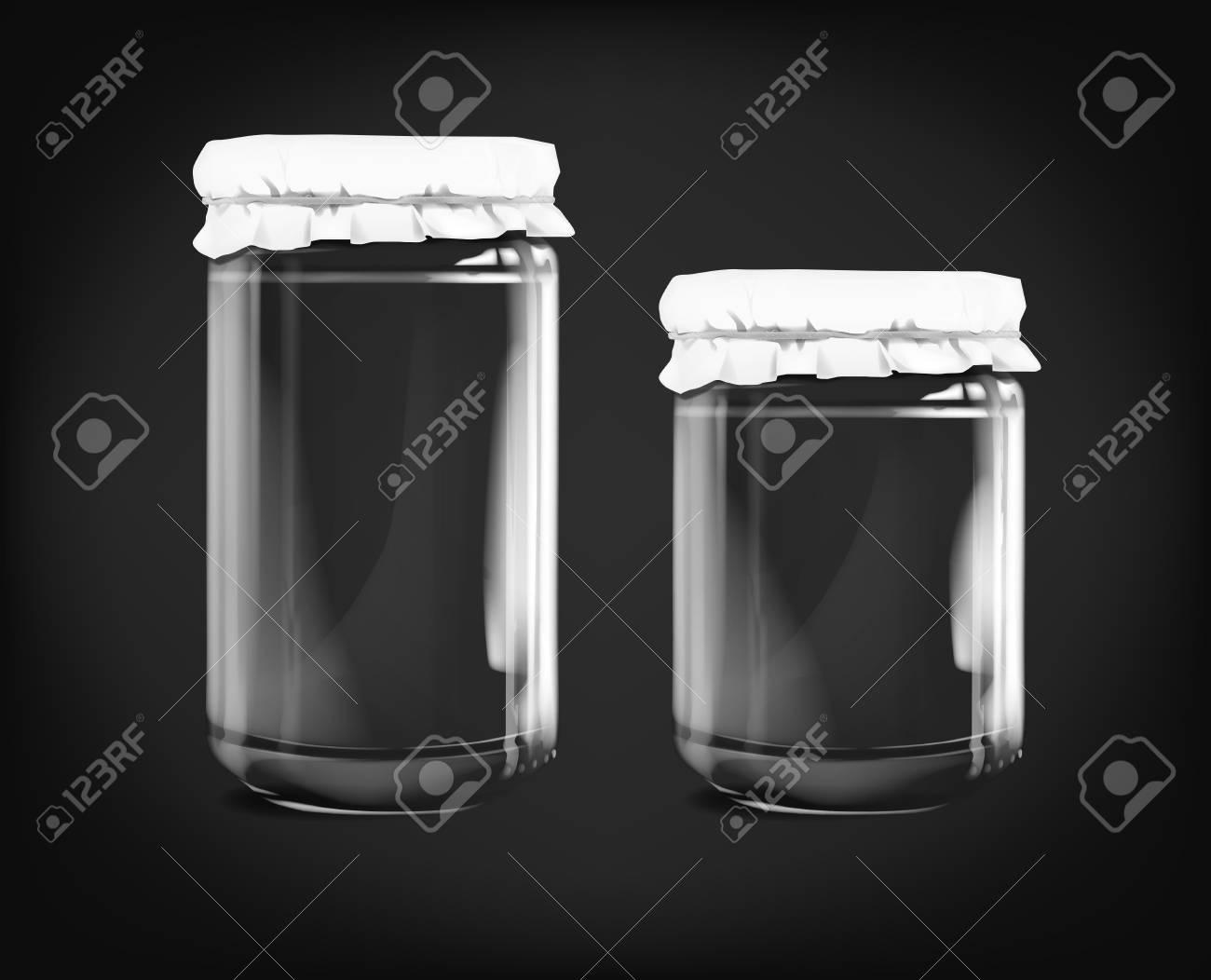 Empty glass jar isolated on dark background. - 125298565